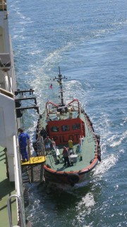 The Pilot Boat arrives to let a Captain jump on board