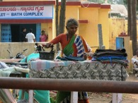 Ironing Outside at the entrance to the Village